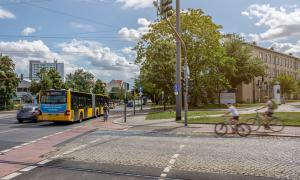 Road crossing with bus stop and cyclists